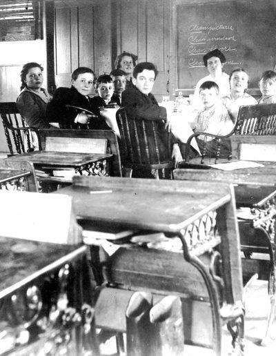 Scholars inside schoolhouse